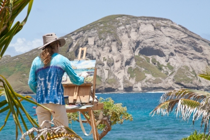 Painter on the Beach.