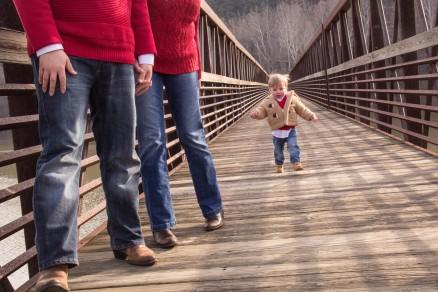 Gabe Walking on Footbridge